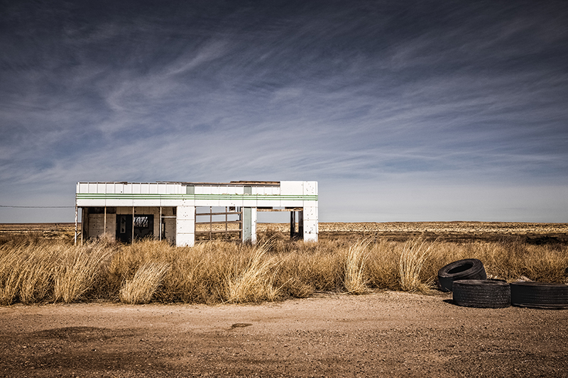 Connect Imagery by Charly image of abandoned gas station